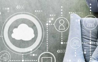 Concept: Data cloud floating above woman on laptop